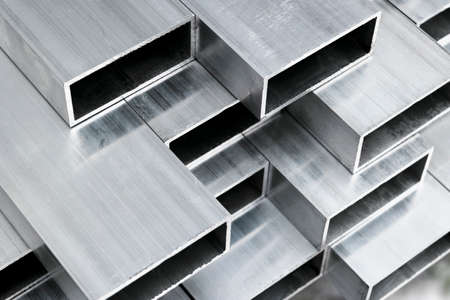Photo for Aluminium profile for windows and doors manufacturing. Structural metal aluminium shapes. Aluminium profiles texture for constructions. Aluminum constructions factory background. - Royalty Free Image