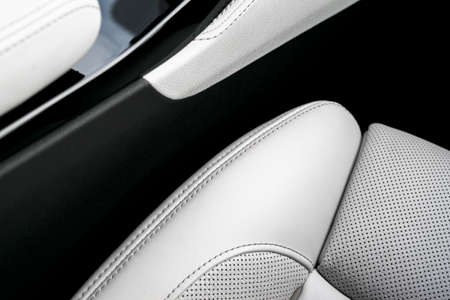 Photo pour Modern luxury Car white leather interior. Part of perforated leather car seat details. White Perforated leather texture background. Texture, artificial leather with stitching. Perforated leather seats - image libre de droit