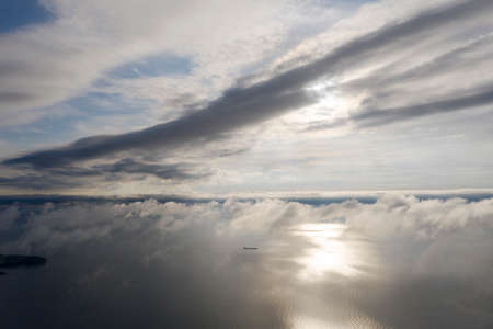 Photo for Aerial view clouds over the sea. View seashore and coastline from drone. Aerial top view cloudscape. Texture of clouds. View from above. Sunrise or sunset over clouds. Aerial ocean backgrounda - Royalty Free Image