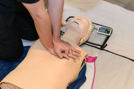 CPR First Aid Training with CPR dummy in the class