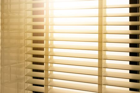 Photo pour Close-up open venetian blinds. lighting range control sunlight coming from a window. decoration interior. Modern jalousie. - image libre de droit