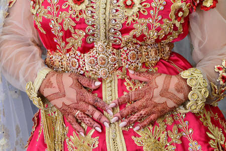 Photo pour Moroccan caftan in blue. Dressed by the Moroccan bride on her wedding day. Moroccan caftan is one of the most famous traditional clothing in the world - image libre de droit
