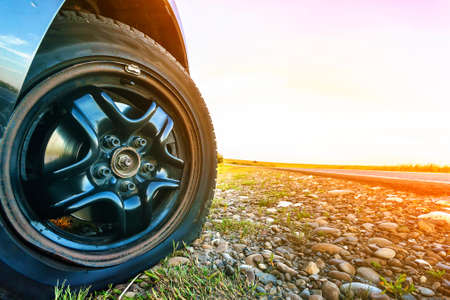 Photo pour Close up of flat tire on a car on gravel road. - image libre de droit