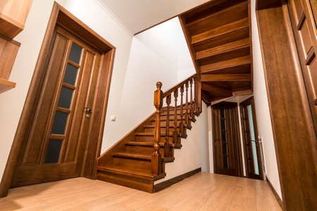 Foto de Modern brown oak wooden stairs  and doors in new renovated house interior - Imagen libre de derechos