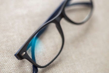 Photo pour Reading spectacles, fashionable eyeglasses isolated on blurred white copy space background. - image libre de droit