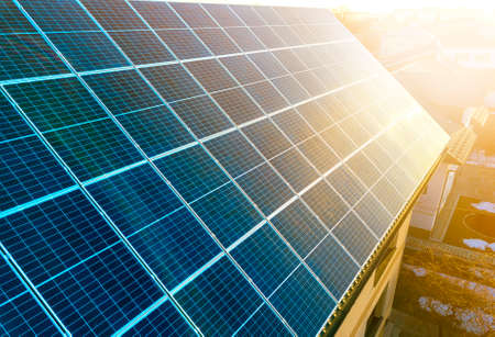 Photo for Close-up surface of lit by sun blue shiny solar photo voltaic panels. System producing renewable clean energy. Renewable ecological green energy production concept. - Royalty Free Image