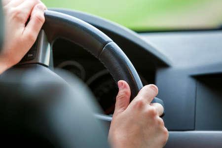 Photo pour Woman hands on steering wheel driving a car. - image libre de droit