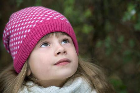 Foto de Pretty child girl in warm knitted winter clothes outdoors. - Imagen libre de derechos
