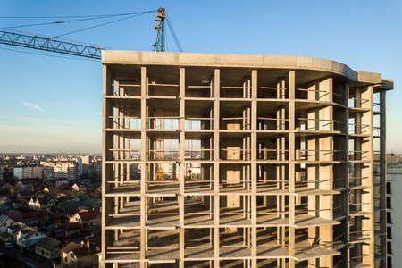 Photo pour Aerial view of concrete frame of tall apartment building under construction in a city. - image libre de droit