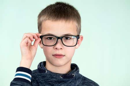 Photo pour Close up portrait of a child school boy wearing glasses. - image libre de droit