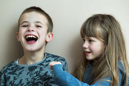 Photo for Two children boy and girl fooling around having fun together. Happy childhood concept. - Royalty Free Image