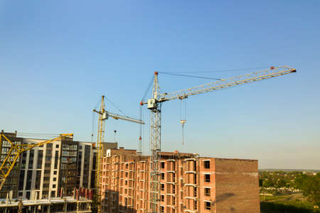 Photo pour High multi storey residential apartment buildings under construction. Concrete and brick framing of high rise housing. Real estate development in urban area. - image libre de droit