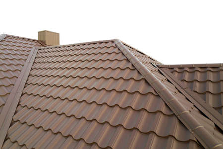Photo pour House roof structure covered with brown metal tile sheets. - image libre de droit