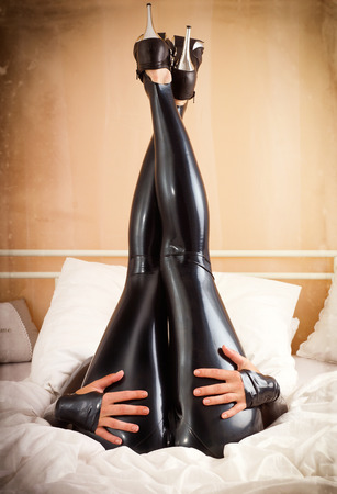 woman in latex in bed