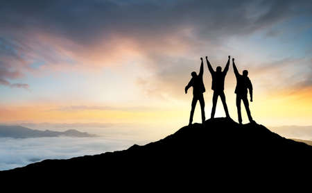 Photo for Silhouette of the team on the peak of mountain. Sport and active life  - Royalty Free Image
