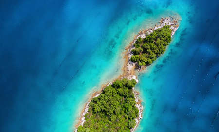 Photo for Aerial view on islands on sea. Seascape from air on the summer time. Azure water and islands with forest. Travel - image - Royalty Free Image