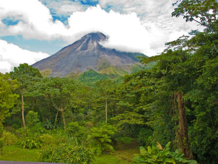 Costa Rican jungle landscape with the arenal volcano in background.