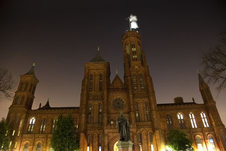 Smithsonian Castle and Smithson Statue Institution Night with Stars Orion Constellation Washington DCResubmit--In response to comments from reviewer have further processed image to reduce noise, sharpen focus and adjust lighting.These are not sensor sp