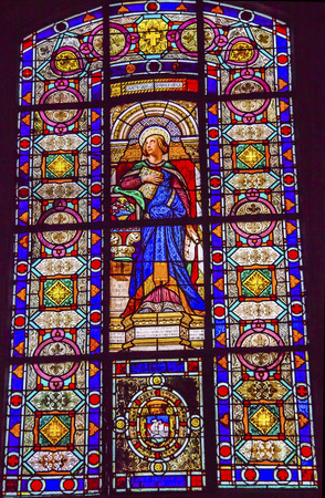 Saint Isabelle Stained Glass Basilica Saint Louis En L'ile Church Paris France. Saint Louis En L'ile church built in Notre Dame was built in 1726 on the island in back of Nortre Dame.  Sainte Isabelle was daughter of King Louis VII and founded a monastery