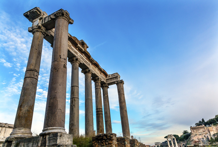 Temple of Saturn Corinthian Columns Roman Forum Rome Italy.  Temple created in 42 BC to celebrate past mythical god king of Rome