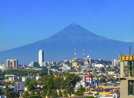 Photo pour Overlook Red Church Buildings Churches Cityscape Volcano Mount Popocatepetl Puebla Mexico - image libre de droit