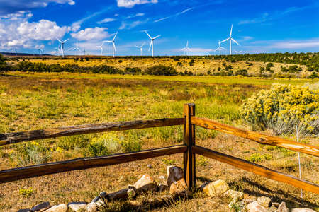Photo for Windmills Large Wind Turbines Farm Fence Sustainable Power Project Monticello Utah. - Royalty Free Image