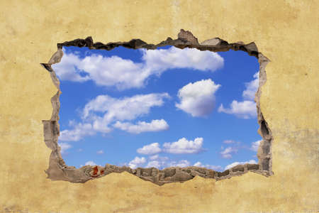 A Hole in a Wall with Blue Sky