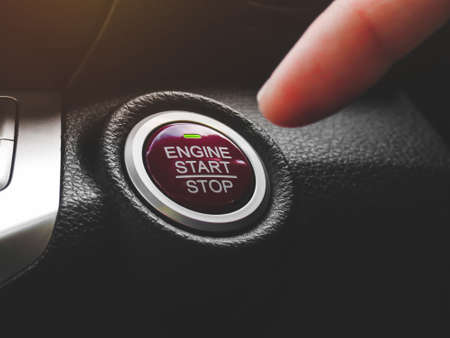 Photo pour Car driver press to the engine start stop button for engine ignition in a luxury car - image libre de droit