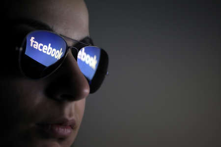 Bucharest, Romania - March 27, 2012: Facebook logo is reflected in a pair of glasses. Facebook is a social networking service launched in February 2004, having more than 845 million active users.
