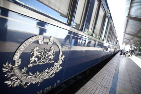 Bucharest, Romania - September 3, 2012: Detail on one of the wagons of the Orient Express train, shortly after arriving in Bucharest. The Venice Simplon-Orient-Express, is a private luxury train service, known as the Orient Express.