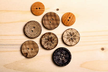 Close up color shot of some wooden buttons