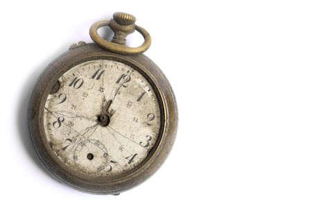 Color image of a broken vintage pocket watch, on white.