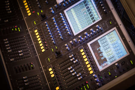 Close up shot of a sound equalizer in a music studio.