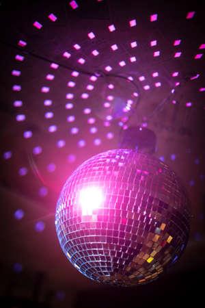 Foto de Color image of a shiny disco ball in a night club. - Imagen libre de derechos