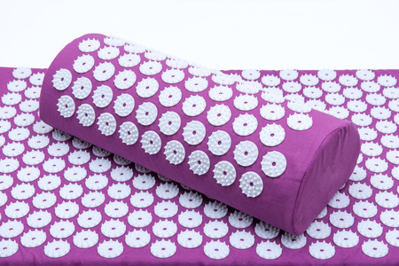 Foto de Acupressure Mat and Pillow Set for Back and Neck Pain Relief and Muscle Relaxation. Relieves Stress, Back, Neck, and Sciatic Pain. - Imagen libre de derechos