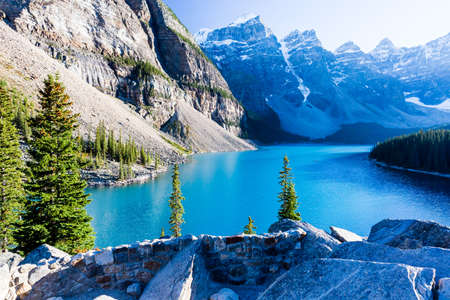 Moraine Lake is a glacially-fed lake in Banff National Park, 14 kilometres outside the Village of Lake Louise, Alberta, Canada. It is situated in the Valley of the Ten Peaks, at an elevation of approximately 1,885 m.