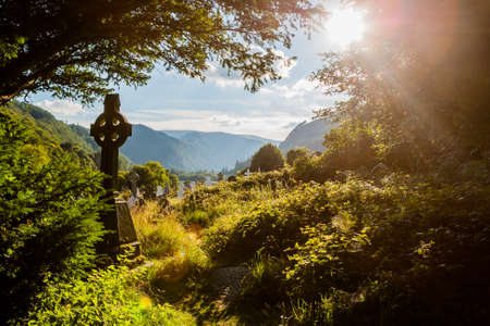 Photo for  Old medieval Celtic Cross at Glendalough in Ireland on August 14th, 2010 - Royalty Free Image