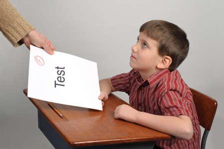 A boy receiving a failing test score