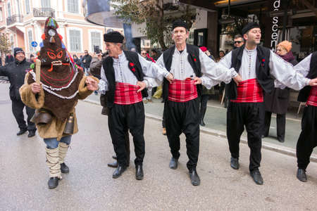 ALEXANDROUPOLIS, GREECE - DEC 31, 2015: Revival of the custom of camel by the Cultural Educational Association of Eastern Rumelia Ebrou around the Town Hall in the city center