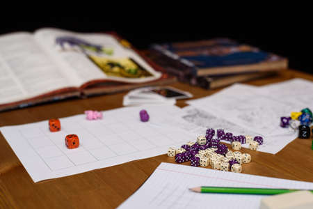 role playing game set up on table isolated on black