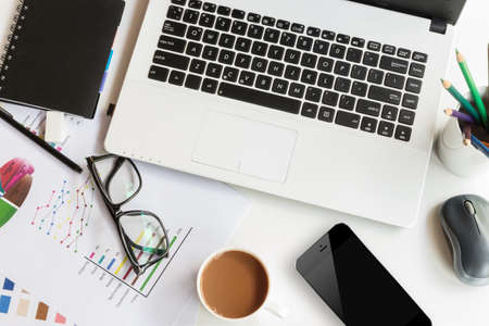Photo pour work table with laptop computer top view - image libre de droit