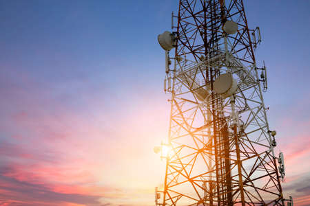 Satellite dish telecom network at sunset communication technology network
