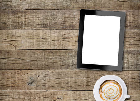 Photo pour tablet white screen display and coffee on old wood background - image libre de droit