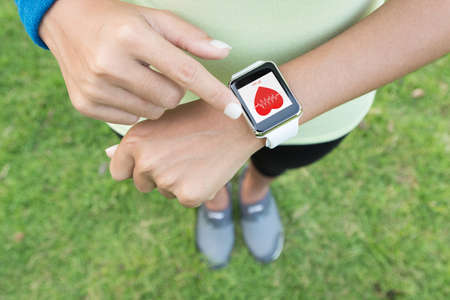 Foto de sport woman touch on hand watch health application - Imagen libre de derechos