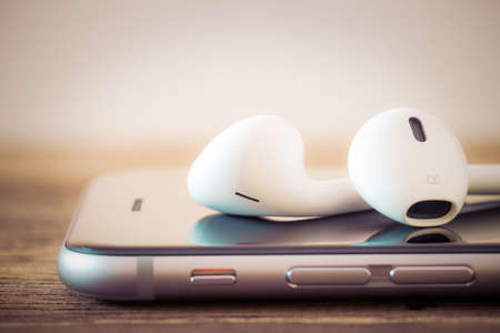 Photo for closeup modern headphone on phone media portable - Royalty Free Image