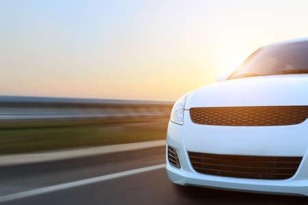 Photo pour movement car speed on asphalt at sunset - image libre de droit