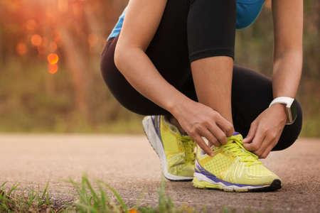 Photo pour woman tying sport shoes ready for run - image libre de droit