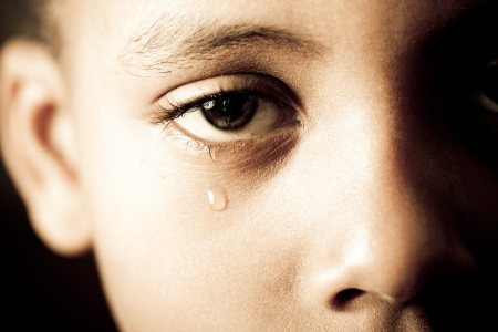 close-up of a boy shedding a tear