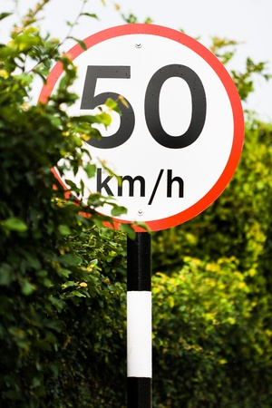 traffic sign indicates 50 km h - slow down at fifty