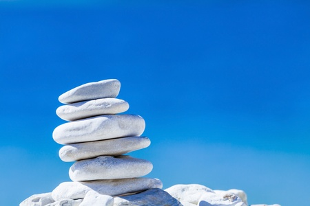 Stones balance hierarchy stack over blue sea in Croatia. Spa or well-being freedom and sta